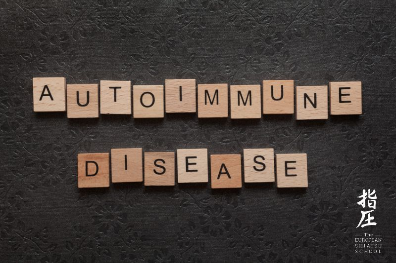 The word autoimmune disease formed with wooden letters on dark background